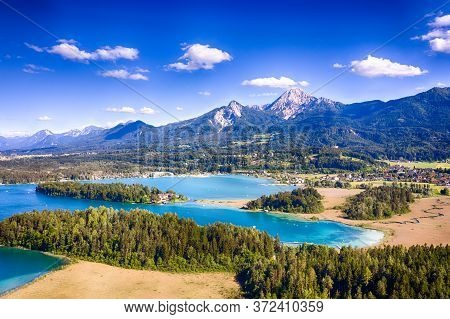 Faaker See In Carinthia. Aerial View To The Beautiful Lake And The Mittagskogel Mountain In The Sout