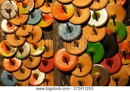 Top View On Colorful Handmade Painted Wooden Toys - Peg Tops Or Whirligigs, As Creative Background W