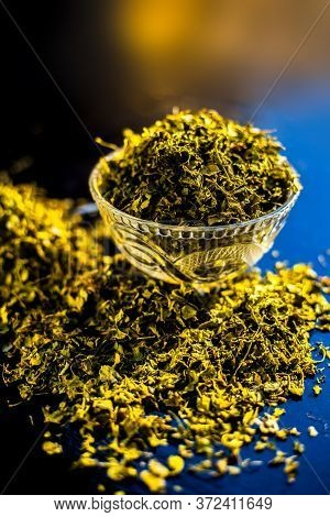 Close Up Short Of Popular Indian Spice Kasuri Methi (dried Fenugreek Leaves) In A Bowl And Some On A