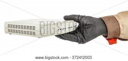 It-specialist Hand In Black Protective Glove Holding Voip Gateway Isolated On White Background