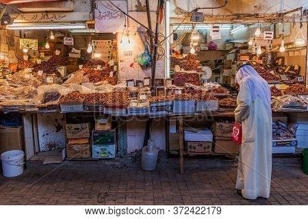 Kuwait City, Kuwait - March 17, 2017: Local Man Shops At A Date Stall At The Souq Market In Kuwait C