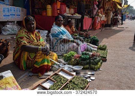 Tulajapur, Maharashtra / India- December 20th 2019; Indian Women Selling Green Bangles In The Market