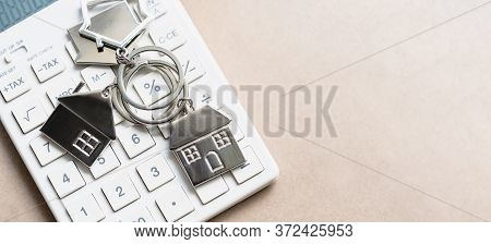 House  On Calculator. Home Interest Rates Calculation. Planning Savings Money To Buy A Home. Mortgag
