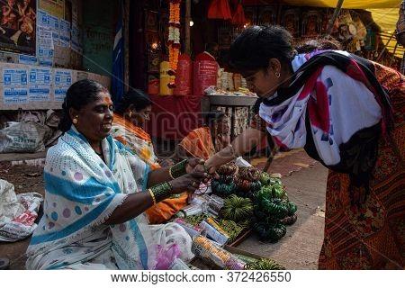 Tulajapur, Maharashtra / India- December 20th 2019; A Girl Wearing Green Color Bangles