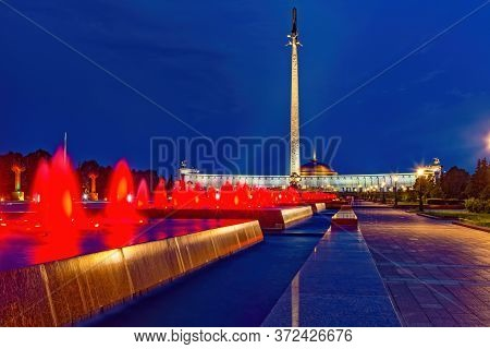 Russia, Moscow - June 19, 2020: Fountains With Red Lights In Victory Park Poklonnaya Gora. Night Ill