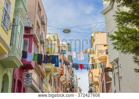 Istanbul, Turkey - October 7, 2019: Underwear Drying On Rope Between The Old Apartment Buildings. La