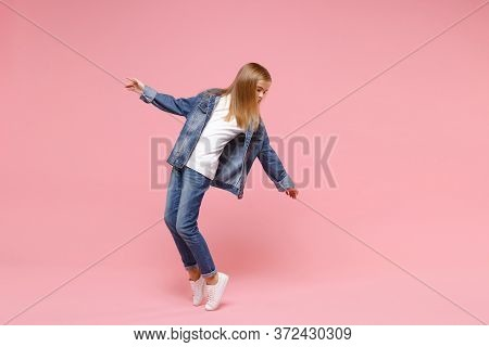 Little Blonde Kid Girl 12-13 Years Old In Denim Jacket Isolated On Pastel Pink Wall Background Child