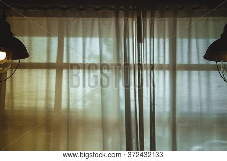White Translucent Curtains On A Big Window Interior View