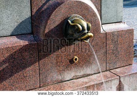 Riga, Latvia, September, 17, 2019: Fish Shaped Fountain With Potable Water In Center Of Riga, Latvia