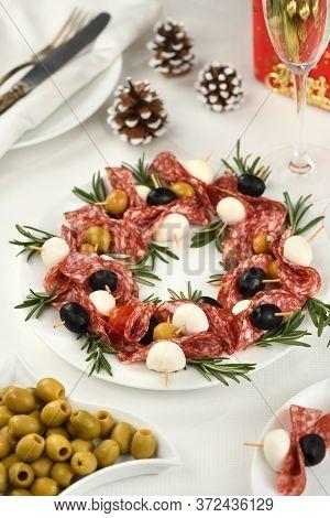 Christmas Wreath - Antipasto. Salami Canapes With Olives, Baby Mozzarella.