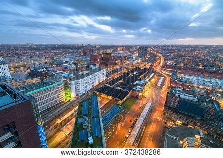 The Hague, Netherlands cityscape overlooking Den Haag HS railway station at twilight.