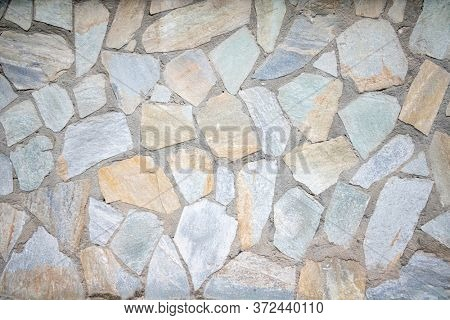 Vintage gray, beige color stone floor background and texture, outdoor flooring grunge material