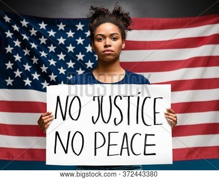 Protest Demonstrations In Usa. Black Woman Standing With Placard No Justice No Peace