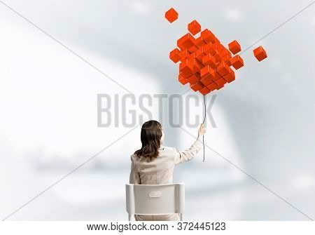 Woman Holding By Rope Abstract Red Composition From 3d Cubes. Back View Long Haired Woman In White S