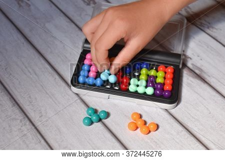 Children's Puzzle Game On Hand Motility. Colored Balls Constructor For Children. Assemble A Puzzle F