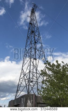 High Voltage Electric Traction Pole Built On A Strong Foundation In Bydgoszcz, Poland Near The Vistu