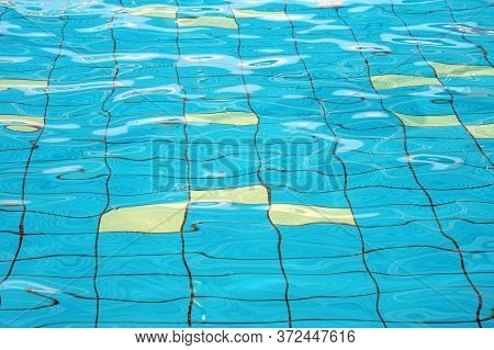Swimming Pool Bottom Caustics Ripple And Flow With Waves Background. Water In Swimming Pool Rippled