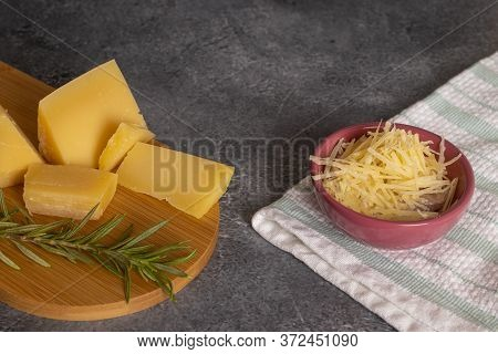 Tray With Pieces Of Parmesan Cheese And Fine Herbs