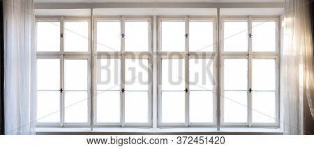 View Through Old Window Concept. Vintage White Window Pane With Frame, Handles And Sill. Sunbeams On
