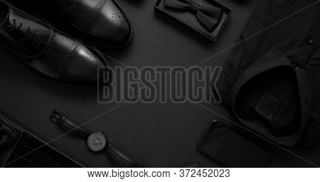 Elegant man clothes concept. Set of black wardobe and accessories for official party evening meeting