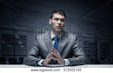 Young Man Folded Hands And Having Serious And Calm Face. Businessman Has Confident Facial Expression
