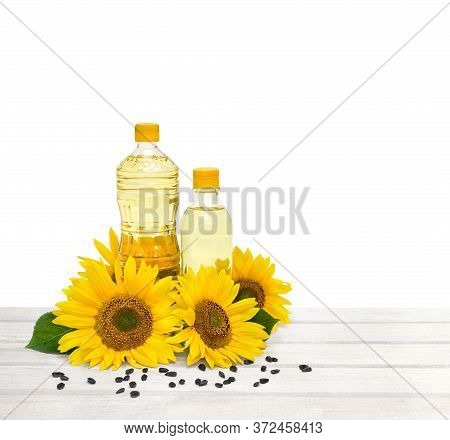 Royalty-free Stock Photo Id: 1411662173  Bottles Of Sunflower Oil With Flowers And Seed Of Sunflower
