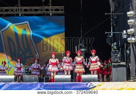 Dnipropetrovsk Region, Ukraine - June 2, 2018: People In Traditional Ukrainian Clothing Performs On