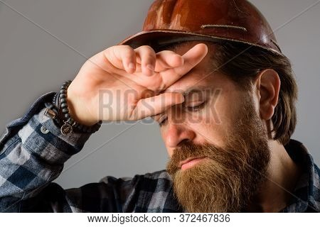 Builder Concept. Building, Industry, Technology. Tired Builder In Hard Hat. Close Up Of Tired Workma