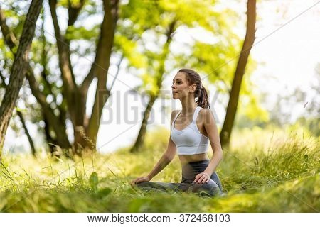 Fit young woman exercising in nature