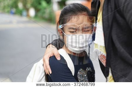 Back To School. Asian Pupil Girl Wearing Face Mask With Backpack Hugging Her Mother Crying First Day