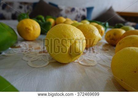 Yellow Fresh Lemons And Green Peper On A Table