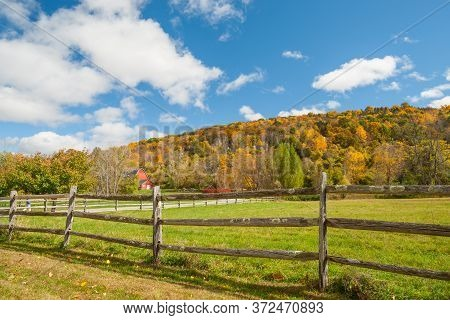 From American Country Road A Rural Landscape With Red Barn In Distance Beyond Rustic Post And Rail F