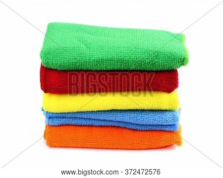 Set Of Color Kitchen Towels Isolated. Folded Towels. Red, Green, Blue And Yellow Towels.kitchen Ware