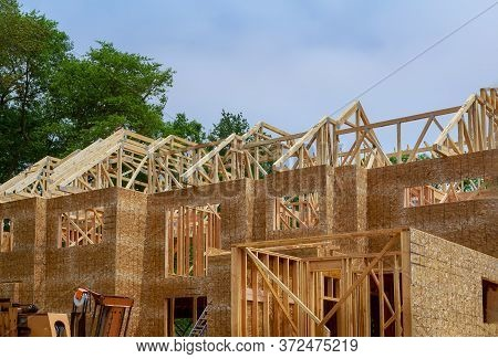 Wooden Roof Framework On Stick Built Home Residential Under Construction Of Attic Beam Framing Again