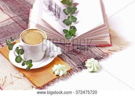 Moning Coffee In White Cup On Background Of Open Book, Marshmallow And Plaid On A Window.beautiful W