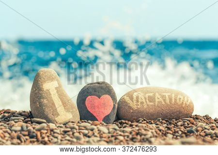 Concept Of Summer Travel And Sea Holiday. Colored Pebble Beach And The Inscription