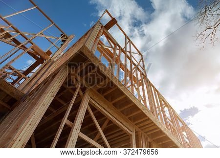 Residential Construction Home Framing On New House Wooden Under Construction Material In Wooden Fram