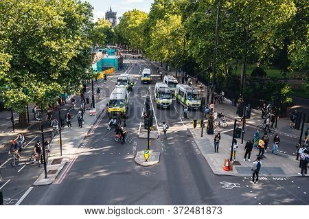 London / Uk - 06/20/2020: Police Vans Going To Trafalgar Square Behind The Huge Crowd Of Blm Protest