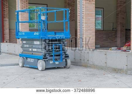 Movable Hydraulic Scissor Lift At Construction Site.