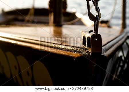 Brown Yacht Bow With Sunset. Summer Calm Rest On Lake, Yachting Hobby. Recreation After Quarantine