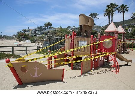 Laguna Beach, CA / USA May 27, 2020: Park Playground closed due to Coronavirus Pandemic shutdown. Due to COVID-19 Parks, Playgrounds, Beaches, and other locations are closed to the public. Editorial.