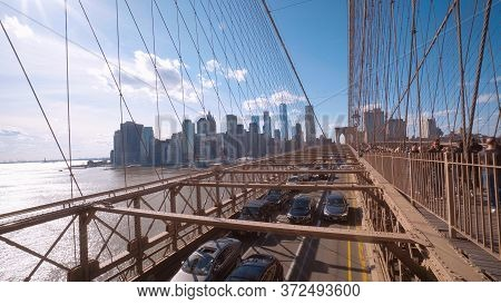 Cars Driving Over Brooklyn Bridge From Manhattan To Brooklyn - New York City, United States - April