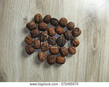 Walnuts Pick Up In Summer On Wooden Background. Healthy Nut Food For Brain. Close Up. Top View Of Fr