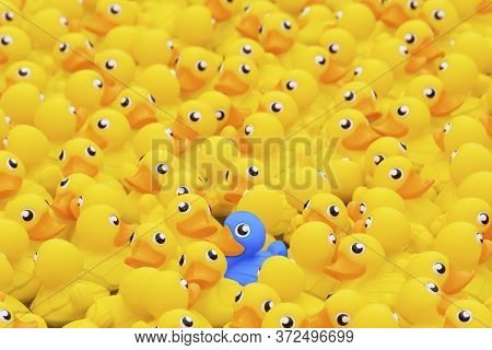 Unique Blue Toy Duck Among Many Yellow Ones. Standing Out From Crowd, Individuality And Difference C