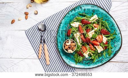 Strawberry Salad With Arugula, Brie Cheese, Camembert. Delicious Breakfast Or Snack On A Light Backg
