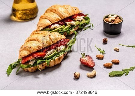 Two Croissants With Filling. Salad With Arugula, Strawberries And Cheese Brie, Camembert. Top View.