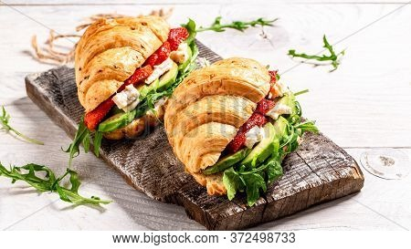 Breakfast Of Fresh Croissant With Arugula, Strawberries And Cheese Brie, Camembert. Healthy Organic