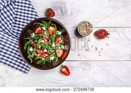 Strawberry Salad With Arugula And Ricotta , White Wood Background, Long Banner Format, Top View.