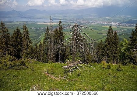 At The Top Of Demanovska Mountain In The Low Tatras. View Of The Valley Of The Liptov Basin With The