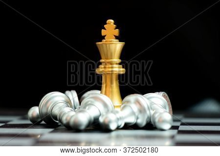 Gold King Chess Piece Win Over Lying Down Pawn On Black Background (concept For Leadership, Crisis M